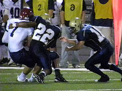 FS Shawn Brown (#22) and CB Justin Beres (#10) securing an open-field tackle against Devils' WR Ryan Cushman