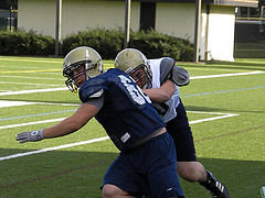 DE Sam Dokus (blue #60) will need to replicate the pressure seen here--during Wednesday's 1v1 segment--Friday @ Kean (allowed only 4 sacks in '09)