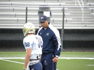 offensive coordinator Bobby Acosta dictating last-minute expectations to Mike Camastra during the receivers' stalk-blocking period