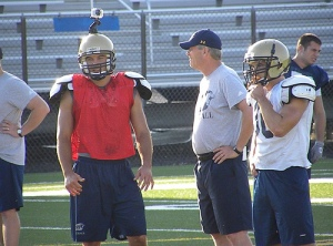James, with quarterbacks' coach James Donoghue between reps during the team's pass-skel segment